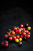 Colourful vine tomatoes on a slate platter