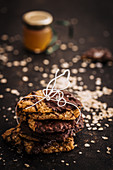 A stack of oat biscuits with chocolate glaze and honey