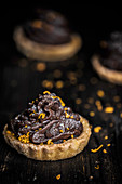 Orange tartlets with chocolate cream and orange zest