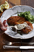Viennese schnitzel with a cucumber salad