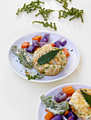 Stinging nettle and tofu fritters with mange tout, carrots and purple potatoes