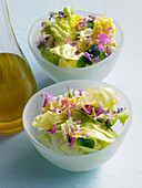Lettuce hearts with spring blossoms and vinaigrette