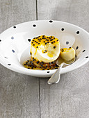 Orange pudding with passion fruit sauce