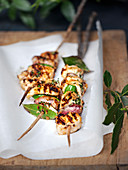 Barbecued chicken skewers with bacon