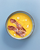 Pumpkin soup with bacon strips