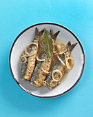 Fried herring with onions and bay leaves