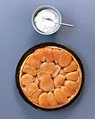 Tarte tatin with apples and whipped cream