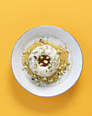 Almond pudding with pistachio nuts and honey