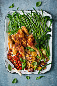 Spatchcock chicken with sun dried tomato paste and spring vegetables
