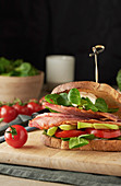 A bacon, tomato, avocado and lamb's lettuce sandwich