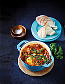 Shakshouka (poached eggs and peppers in tomato sauce, North Africa)
