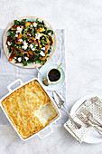 Warm honey-roasted pumpkin, silverbeet and currant salad, mashed potato and chive bake