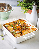 Mince casserole topped with sliced vegetables