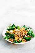 Citrus garlic chicken with warm broccolini