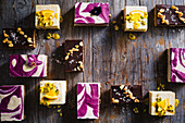 Three ways of bars - passionfruit bliss bars, gooey peanut butter and chocolate fridge bars, blueberry and lemon swirl bars