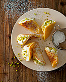 Mini pancakes with pistachio cream and chopped pistachios