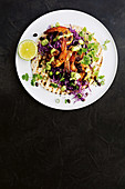 Prawn tacos with black bean salad and creamy avocado dressing