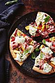 Pizza with prosciutto, pineapple and buffalo mozzarella