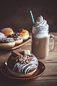 Chocolate donut and jar of coffee, selective focus