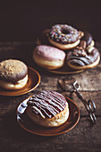 Sweet homemade donuts served on the wooden table, selective focus