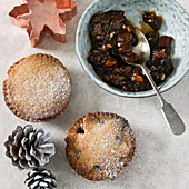 Mince pies, mince pie filling, a cookie cutter, and pine cones