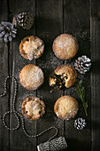 Mince pies with pine cones on a wooden background (top view)