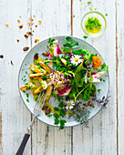 Roasted white asparagus with wild herb salad