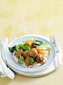 Satay pork meatballs with veg and rice