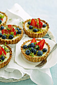 Muesli, yoghurt and blueberry tarts