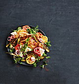 Fattoush salad with grilled aubergines, tomatoes, and onions