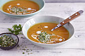 Cream of sweet potato soup topped with pistachios