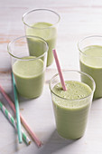 Matcha smoothies in glasses with straws