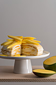 Mille Crepes cake (pancake cake) with cream and mango