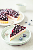A slice of blueberry and cream cheese tart