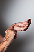 Elderly woman monitoring her wrist pulse