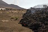 Lava flow advancing on a village, Pico do Fogo