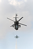Apache helicopter and F-16 fighter