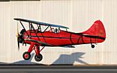 Waco UPF-7 biplane taking off