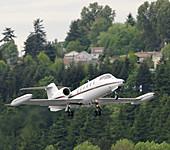 Learjet taking off