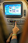 Economy class airline in-flight entertainment