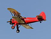 Waco UPF-7 biplane in flight