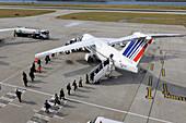 Passenger disembarking aircraft