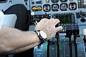 Pilot's hand on throttle
