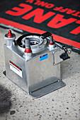 Racing car fuel surge tank