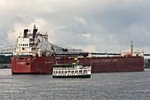 Tour boat and cargo ship, Soo Locks, Michigan, USA