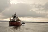 Ship taking on supplies, Michigan, USA