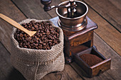 Coffee beans in hessian sack and grinder