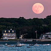 Full moon over coastal houses