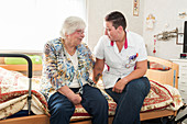 Nurse talking to an elderly woman