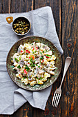Potato salad with herring, capers and apple, mayo sauce